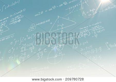 Maths over black background against blue sky