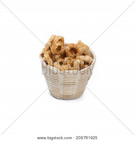 Pork rind in bamboo basket isolated on white