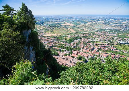 Panorama of Republic of San Marino and Italy from Monte Titano City of San Marino. City of San Marino is capital city of Republic of San Marino located on Italian peninsula near Adriatic Sea.