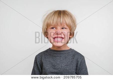 New horisontal emotional portrait of caucasian boy
