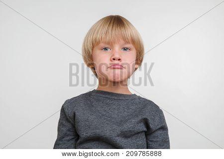 New cool horisontal emotional portrait of caucasian boy