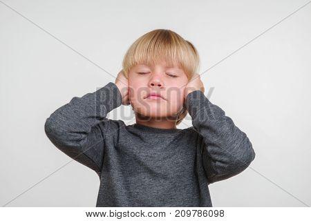 Cute horisontal photo of handsome happy caucasian child