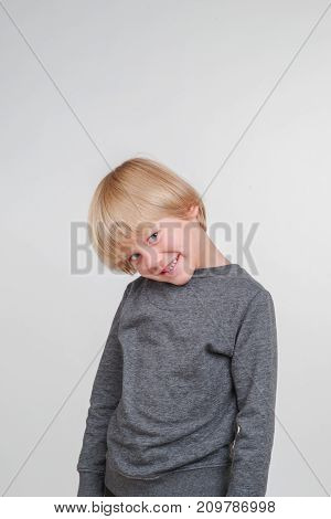 Vertical emotional portrait of caucasian boy. Handsome happy child, isolated on white background