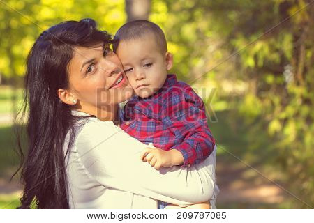 Mother Holding A Baby Son In Her Arms