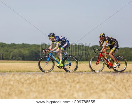 Vendeuvre-sur-Barse France - 6 July 2017: Two cyclists (Backaert of Wanty-Groupe Gobert Team Quemeneur of Direct Energie Team) in the breakaway pass through a region of wheat fields during the stage 6 of Tour de France 2017.