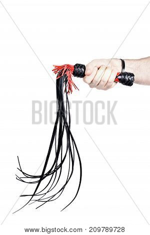 A man's hand holding a whip (isolated on white) Fine leather dress very painful hit in low stroke of