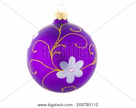 A beautiful violet shiny ball for Christmas tree isolated on a white background. New Year decoration for the house and pine. Holidays concept.