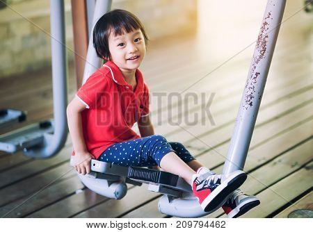 Asian little girl on swing