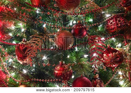 Christmas decorations hanging on tree with lights