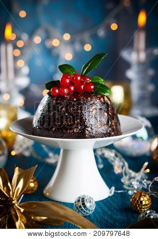 Christmas pudding decorated with holly