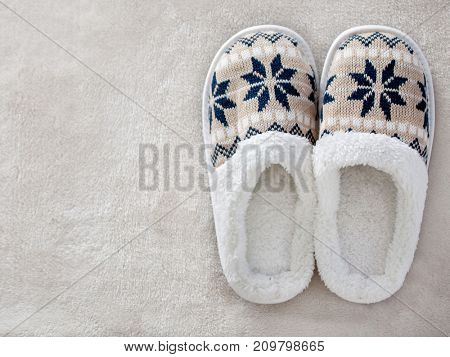 Slippers on the carpet. Soft comfortable home slipper