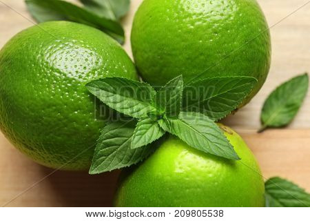 Limes and mint on table, closeup