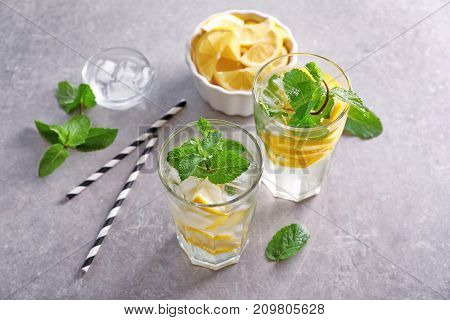 Composition with fresh mojito cocktails on grey background