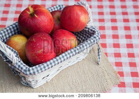 fresh organic apples in basket