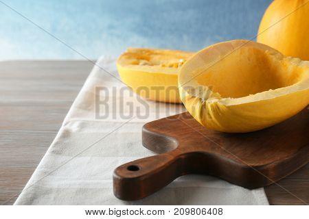 Cut spaghetti squash on wooden board