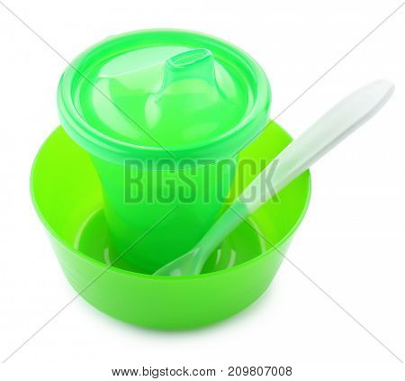 Bright baby tableware on white background
