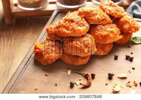 Tasty sausage balls on wooden board