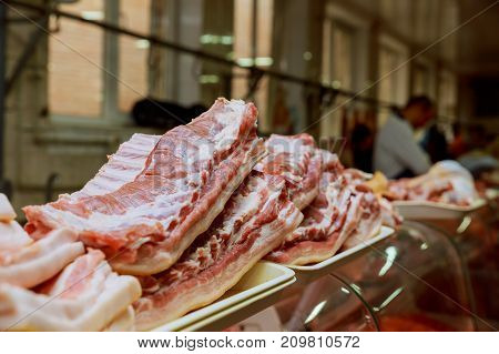 Fresh Pork For Sell In Local Market. Seller Cut Pork To Pieces.