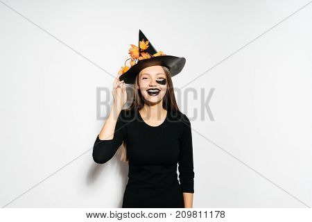 girl in unfinished witch costume on halloween smiling