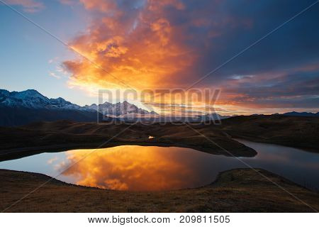 Scenic image of the lake Koruldi at the foot of Ushba. Location Upper Svaneti, Mestia, Georgia, Europe. High Caucasus ridge. Perfect wallpapers. Discover the beauty of earth. Great photo of wild area.