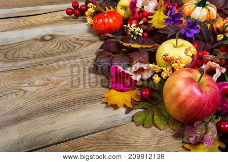 Thanksgiving Centerpiece With Apples, Fall Leaves, Pink And Purple Flowers