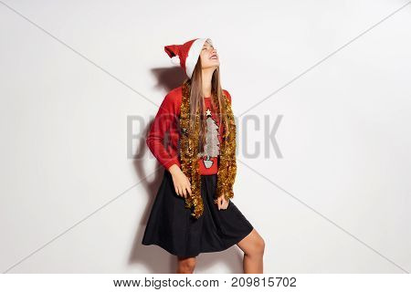 upset girl in a New Year costume on a white background