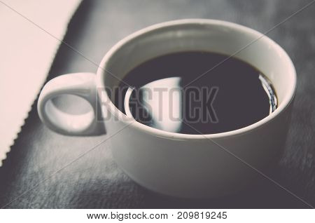 Coffee Cup And Saucer On A Wooden Table .