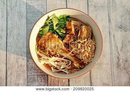 Steam Duck And Instant Noodles In Brown Sauce.