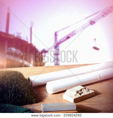 Architecture equipment on table against  crane and building construction site  Crane and building construction site on a sunny day