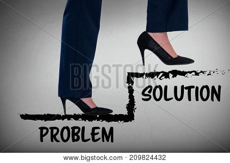 Conceptual image of businesswoman in heels climbing steps against grey room
