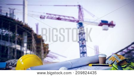 Panoramic shot of architecture equipment on table against work in progress in the city