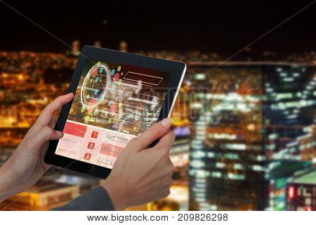 Cropped 3D image of businesswoman holding digital tablet against high angle view of illuminated crowded cityscape