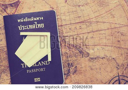 thailand passport on map and wood home