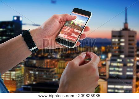 Close-up of man holding 3D mobile phone against illuminated buildings in city against sky