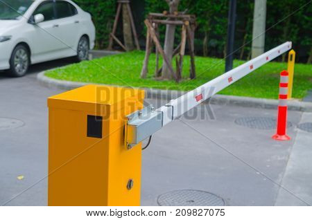 Security system for building access - barrier gate stop with toll booth traffic cones and cctv