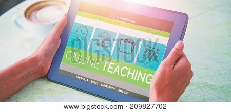3D computer graphic image of e-learning interface on screen against person holding tablet computer at table in cafe