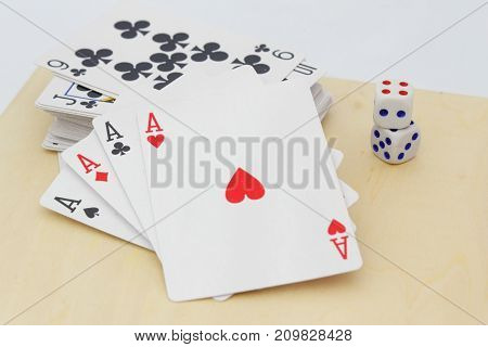 Four aces in the foreground. Concept of gambling.