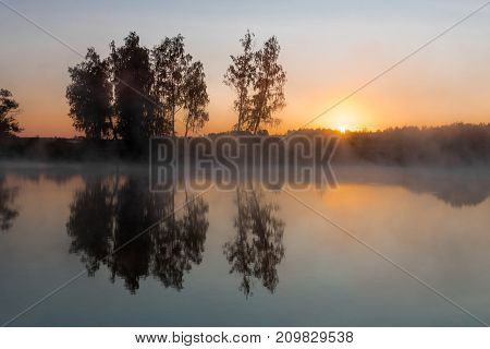 A misty dawn over the river. Russia.