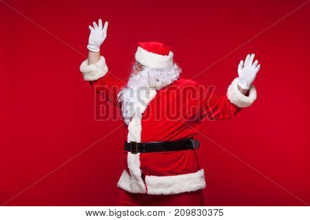 Santa Claus is dancing Isolated on red background