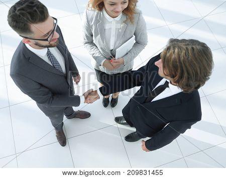 Business men shaking hands making an agreement