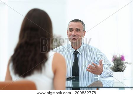 business consultant sits at his Desk and consult with their client