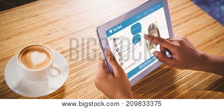3D interface of chat application against woman using digital tablet with blank screen at table in cafe