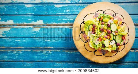 Overhead view of fresh food on blue wooden table
