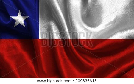 Realistic flag of Chile on the wavy surface of fabric. This flag can be used in design.