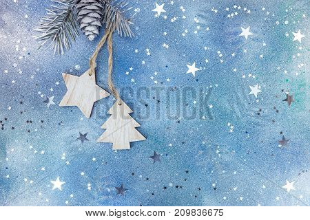 Wooden Christmas Holiday Decorations On Silver-blue Background