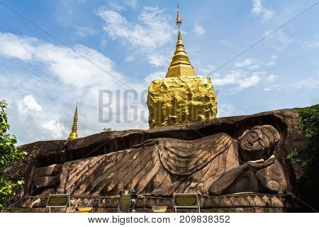 Golden pagoda sculpturestone carving at Wat Tham Pha Daen.Sakon NakhonThailand( Generality in Thailandand kind of art decorated in Buddhist churchtemple paviliontemple hall.They are public)