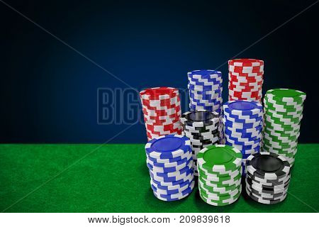 Computer generated 3D image of gambling chips against blue background with vignette