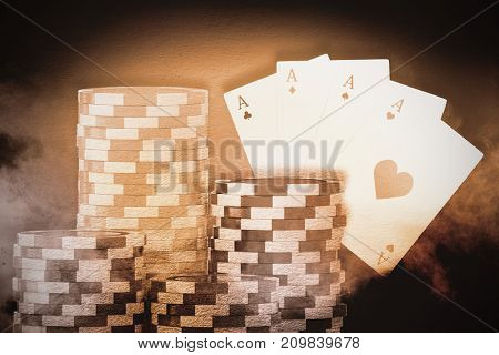 Vector 3D image of gambling chips against digitally generated image of color powder