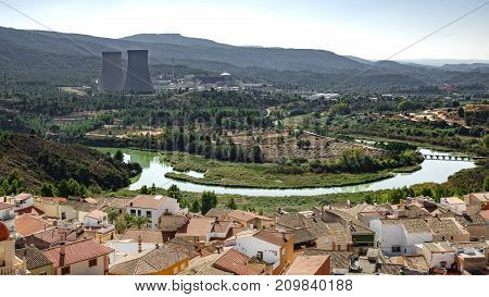 Jucar river meander near Cofrentes village roofs and nuclear plant in the background n2