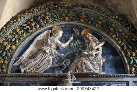 LUCCA, ITALY - JUNE 03: Lunette of The Annunciation, school Andrea della Robbia, Basilica of Saint Frediano, Lucca, Tuscany, Italy on June 03, 2017.